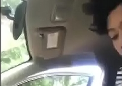 Cute Indonesian Girl With Big Tits Sucks On Dick Adjacent to The Car