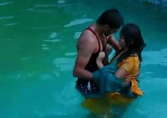 Lovers hot romance concerning swimming pool