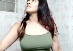 Bangladeshi girl close to the bathroom