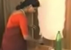 red saree lady removing dress and enjoying near young guy.3GP