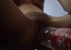 Teen with big kingfisher bottle