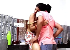 Indian couple romance in kitchen