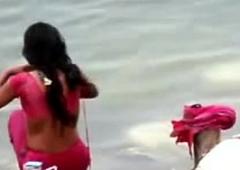 Indian unfocused ablution in ganges brooklet backless honest